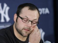 Yankees' Joba Chamberlain gets emotional as he speaks about his relationship with his son during a news conference in Tampa, Fla.