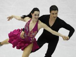 Tessa Virtue and Scott Moir of Canada scored a 72.31 to take the lead after Ice Dance short program.