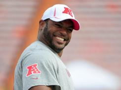 A financial adviser is being accused of swindling $2.2 million from Dwight Freeney (pictured).