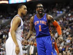 Veteran New York Knicks forward Amar'e Stoudemire, right, will be out with a bulging disk during the team's critical stretch drive toward the playoffs.