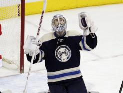 Blue Jackets goalie Allen York celebrates his first NHL win after defeating the Red Wings on Wednesday night.