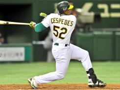 Oakland's Yoenis Cespedes hits a two-run homer to put the A's ahead en route to a 4-1 win over Seattle in Tokyo.