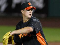 Giants starting pitcher Matt Cain went 12-11 last season with a 2.88 ERA.