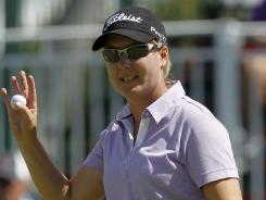Lindsey Wright of Australia acknowledges the cheers after a waves birdie on the ninth hole on her way to a first-round 67 on Thursday in the Kraft Nabisco Championship.