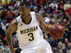 Michigan guard Trey Burke got some advice from a surprise location as he considers entering the NBA draft.