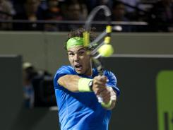 Rafael Nadal of Spain fires a backhand during his victory against Jo-Wilfried Tsonga of France.