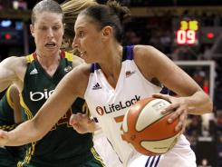 The Phoenix Mercury's Diana Taurasi (right) drives past the Seattle Storm's Katie Smith during a WNBA basketball game Aug. 16, 2011, in Phoenix. Taurasi was named to the U.S. Olympic team on Friday.