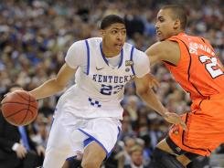 Kentucky forward Anthony Davis goes around the defense of Louisville forward Jared Swopshire.