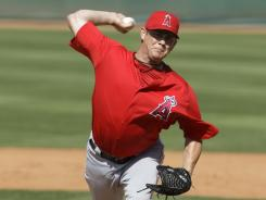 Jason Isringhausen, who has 300 career saves, was added to the Angels 40-man roster.