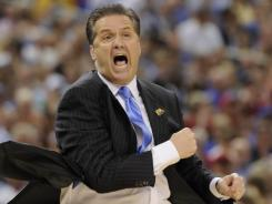 Kentucky coach John Calipari will coach in the national title game for the second time after the Wildcats beat Louisville.