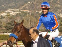In this file photo, co-owner Joe Torre guides Game On Dude and jockey Chantal Sutherland into the winner's circle after the Grade II, San Antonio Stakes horse race on Feb. 5, 2012, at Santa Anita in Arcadia, Calif.