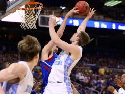 If Kansas center Jeff Withey (rear) can block shots against Ohio State as he did against Tyler Zeller of North Carolina, the Jayhawks have a chance of advancing to the national title game.