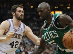 Celtics forward Kevin Garnett (5) dribbles past Minnesota forward Kevin Love during the second quarter at the Target Center.