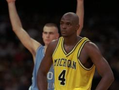 In this April 5, 1993, file photo, Michigan's Chris Webber stands by as North Carolina's Eric Montross celebrates during North Carolina's technical foul shots in the final seconds of their Final Four championship game at the Superdome in New Orleans. Webber called a time out Michigan did not have. Under the rules at the time, Michigan was charged with a technical foul and lost possession of the ball.