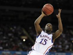 Kansas guard Elijah Johnson shoots during the Jayhawks' national semifinal game against Ohio State on Saturday.