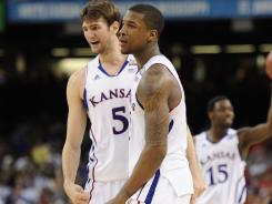 Kansas center Jeff Withey, right, and forward Thomas Robinson will be looking to take down Kentucky in the title game Monday.