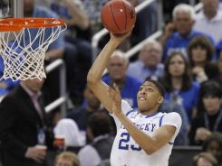 Kentucky's Anthony Davis shoots over Louisville during the second half.