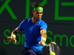 Rafael Nadal of Spain withdrew from the Sony Ericsson Open before the semifinals because of a nagging left knee injury.