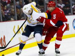Predators right wing Alexander Radulov and Red Wings defenseman Nicklas Lidstrom battle for the puck in the third period of their Friday game.
