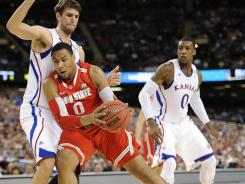 Ohio State forward Jared Sullinger, right, struggled against the defense of Kansas center Jeff Withey.