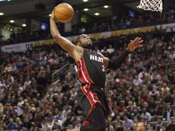 Heat guard Dwyane Wade soars for a monster slam against the Raptors on Friday night. Wade scored 30 points in the win.