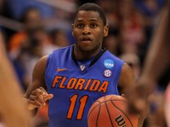 Erving Walker, who helped lead Florida to the Elite 8 in this year's NCAA Tournament, was charged with petty theft for stealing a taco from a food stand and running from police.