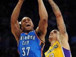 Oklahoma City guard Derek Fisher scored seven points in his return to Los Angeles in the Thunder's 102-93 victory over the Lakers on Thursday night at Staples Center.