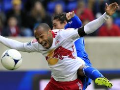 New York Red Bulls forward Thierry Henry, front, reacts as he is hit from behind by Montreal Impact's Zarek Valentin during the first half on Saturday.