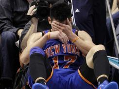 New York Knicks' Jeremy Lin reacts after being fouled during a game against the Dallas Mavericks in Dallas. Lin is having left knee surgery and will miss six weeks, likely ending his amazing breakthrough season.