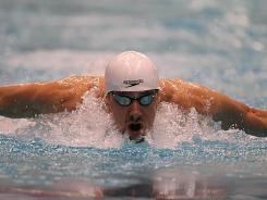 Michael Phelps swims the butterfly in the men's 200 meter individual medley during the championship final at the Indianapolis Grand Prix at the Indiana University Natatorium. Phelps won the race.