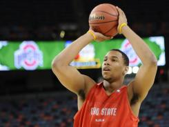 Buckeyes forward Jared Sullinger shoots during practice Friday.