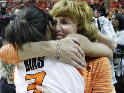 Shelley Budke, right, the widow of Kurt Budke, the Oklahoma State women's basketball coach who died in a plane crash in November hugs guard Tiffany Bias (3) following WNIT Championship win.