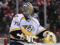 Goalie Pekka Rinne and the Predators jumped the Red Wings in the standings with a 4-1 victory Friday at Detroit.