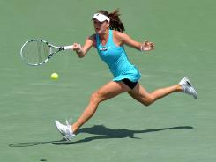 Agnieszka Radwanska of Poland chases down a forehand during her victory against Maria Sharapova of Russia on Saturday in the Sony Ericsson Open final.