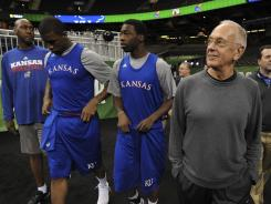 Former coach Larry Brown, right, guided the Kansas Jayhawks to a National Championship in 1988.