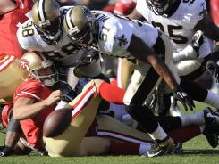 New Orleans Saints linebacker Jonathan Vilma (51), shown sacking San Francisco 49ers quarterback Alex Smith during last season's playoffs, is among the Saints players who could be involved in the bounty program.