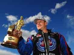 Robert Hight celebrates after earning his third straight Funny Car win at the Summitracing.com Nationals at The Strip in Las Vegas.