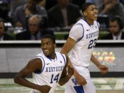 Kansas will have its hands full trying to stop Kentucky's Michael Kidd-Gilchrist, left, and Anthony Davis.