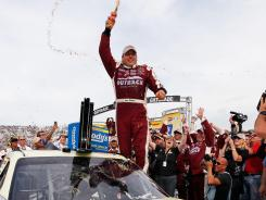 Ryan Newman celebrates in victory lane after winning the Goody's Fast Relief 500.