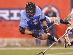 North Carolina's Marcus Holman goes airborne to score in the upset of Johns Hopkins.