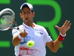 Novak Djokovic of Serbia lines up a forehand during his victory Sunday against Andy Murray of Britain in the final of the Sony Ericsson Open.
