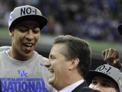 Kentucky coach John Calipari and Anthony Davis celebrate after defeating the Kansas Jayhawks in the NCAA championship game in New Orleans on Monday.