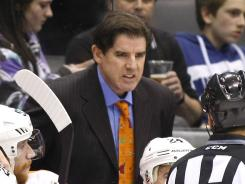 Flyers coach Peter Laviolette was $10,000 Monday in the aftermath of his shouting match with Penguins assistant coach Tony Granato.