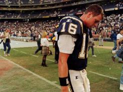 Pictured in 1998, former San Diego Chargers quarterback Ryan Leaf walks off the field following a 27-20 loss to the Seahawks.