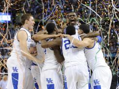 Kentucky celebrates a 67-59 victory against Kansas in the NCAA championship game on Monday in New Orleans.