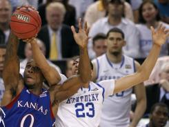 Kansas' Thomas Robinson (0) grabs a rebound in front of Kentucky's Anthony Davis during the second half Monday night. Robinson and the Jayhawks struggled mightily in the first half.
