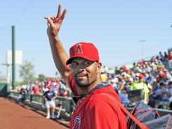 "Albert Pujols, waving to fans in Tempe, Ariz., on March 6, says he's not resting on his considerable career laurels: ""I want all of the players to know I'm not satisfied with the numbers I've put up and the World Series I won."""
