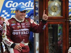 Ryan Newman stands next to the grandfather clock awarded to Martinsville Speedway winners. Sunday marked Newman's first victory at the 0.526-mile oval in 21 Sprint Cup starts there.