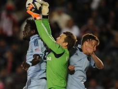 Sporting KC forward Kei Kamara (left) and Sporting KC defenseman Matt Besler attempt to head the ball on a corner kick defended by Chivas USA goalkeeper Dan Kennedy during the second half at the Home Depot Center.