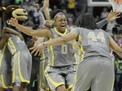 Baylor guard Odyssey Sims, forward/center Mariah Chandler (44) and other Lady Bears players celebrate after beating Notre Dame for the NCAA women's basketball title Tuesday night.